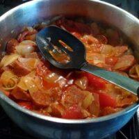 Sausage on stove with veggies