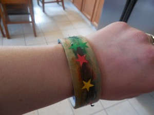After the bracelet is colored, have the kids put stickers all over.  This is great for fine motor skills.