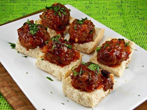 The Tasty Fork - Crock Pot Meatball Sliders with Peach Chipotle BBQ Sauce #tailgatingrecipes #gamedayrecipes