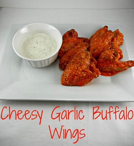 The Tasty Fork - Cheesy Garlic Buffalo Wings. #gameday #tailgatingrecipes