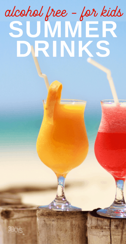 image of two tropical drinks with umbrellas on a fence surrounding a beach.
