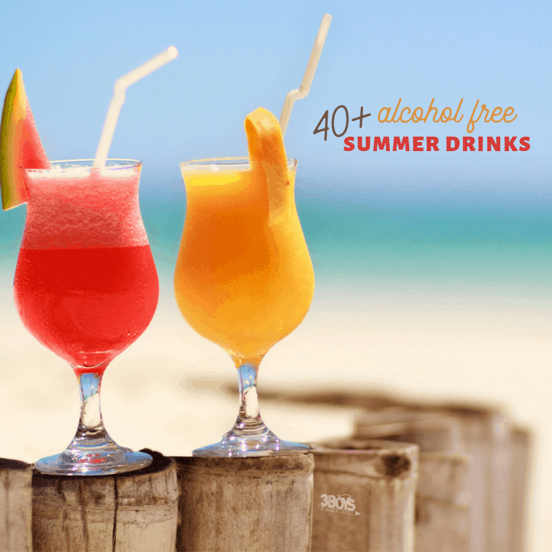 square image of two tropical drinks with umbrellas on a fence surrounding a beach.