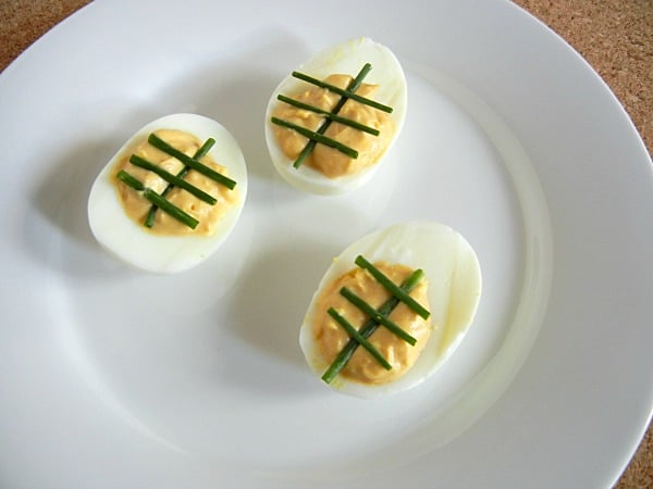 Tailgating Deviled Eggs. Make your deviled eggs look like footballs! This recipe has some spice. Get the recipe at 3 Boys & a Dog! It's the Ultimate Tailgating Party!