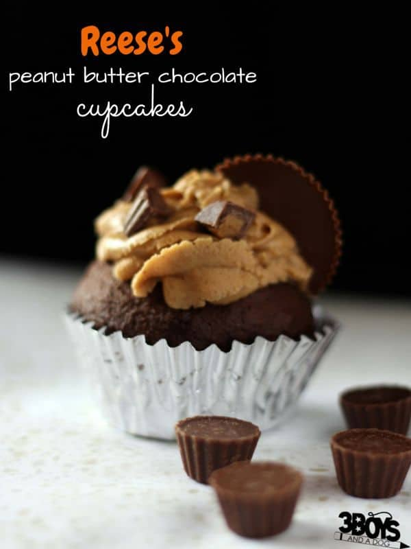 Reese's Peanut Butter Chocolate Cupcakes - the perfect excuse to stock up on Hallowe'en candy! The best chocolate cake with a rich peanut butter frosting and chocolate peanut butter center topped with cute mini Reese's peanut butter cups - yum.