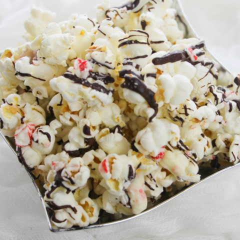 popcorn with peppermint bark and chocolate drizzle