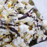 chocolate peppermint popcorn with crushed candy canes