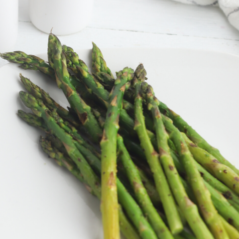 fresh asparagus spears grilled on an indoor grill